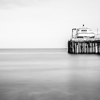 Malibu Pier black and white panorama photo in Malibu California. Malibu is a beach city along the Pacific Ocean in Southern California in the United States.