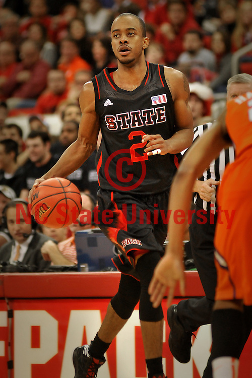 Wolfpack point guard Lorenzo Brown moves the ball up court against Clemson in an ACC regular season home win.