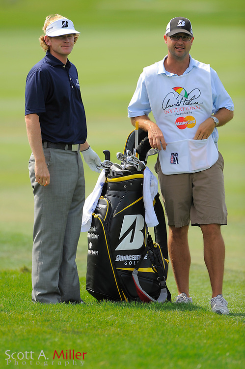 March 27, 2009; Orlando, FL, USA; Brandt Snedeker and his caddie discuss a shot on the first hole during the second round of the Arnold Palmer Invitational at the Bay Hill Club and Lodge. ©2009 Scott A. Miller