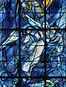 Abraham receiving the 3 angels at Mamre, stained glass window, 1974, by Marc Chagall, 1887-1985, with the studio of Jacques Simon, in the axial chapel of the apse of the Cathedrale Notre-Dame de Reims or Reims Cathedral, Reims, Champagne-Ardenne, France. The cathedral was built 1211-75 in French Gothic style with work continuing into the 14th century, and was listed as a UNESCO World Heritage Site in 1991. Picture by Manuel Cohen