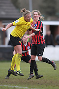 Holly Wride and Charlotte Gurr challenge during the Women's FA Cup match between Watford Ladies FC and Brighton Ladies at the Broadwater Stadium, Berkhampstead, United Kingdom on 1 February 2015. Photo by Stuart Butcher.