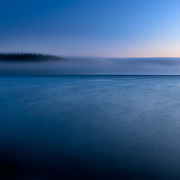 The fog rolls back into Marthas Beach at sunset in Washinton.