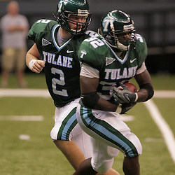 20 September 2008: Tulane quarterback Kevin Moore (2) hands off to Tulane running back Andre Anderson (32) during a Conference USA match up between the University of Louisiana Monroe and Tulane at the Louisiana Superdome in New Orleans, LA.