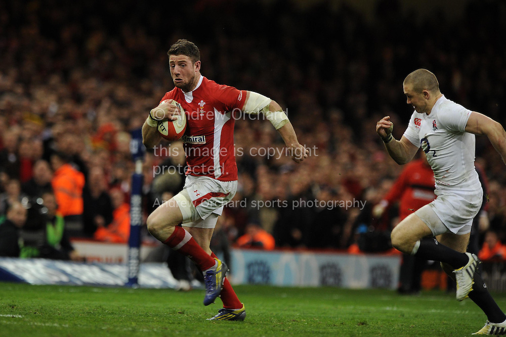 Alex Cuthbert of Wales breaks away to score his 1st try. RBS Six nations championship 2013, Wales v England at the Millennium stadium in Cardiff , South Wales on Saturday 16th March 2013. pic by Andrew Orchard, Andrew Orchard sports photography,