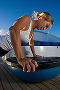 Fitness trainer shows yacht crew workout suggestions that can be done effectively in the reduced space available to crew members living aboard yachts.