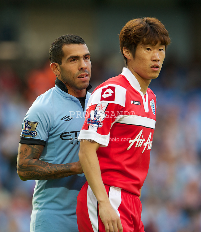 MANCHESTER, ENGLAND - Saturday, September 1, 2012: Manchester City's Carlos Tevez and Queens Park Rangers' Ji-Sung Park during the Premiership match at the City of Manchester Stadium. (Pic by David Rawcliffe/Propaganda)