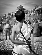A child dressed as martyr of Saint Sebatião during the procession of St. Bartolomeu. The procession to thank the Saint incorporates hundreds of extras and large litters, which reconstruct biblical episodes. This tradition that dates back to the sixteenth century (1566), and it claims the devil is on the loose during this day. Every year on 24 August  faith and tradition join thousands of people at the feast of St. Bartolomeu do Mar, for ritual that mixes the sacred and the profane.