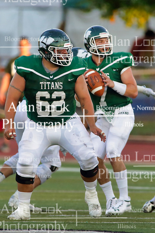 {BLOOMINGTON, IL: Kyle Cook provides blocking for  Brandon Bauer during a college football game between the IWU Titans  and the Wheaton Thunder on September 15 2018 at Wilder Field in Tucci Stadium in Bloomington, IL. (Photo by Alan Look)