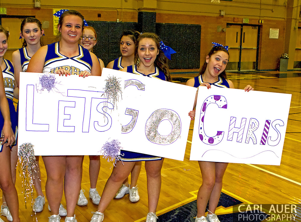 The Wheat Ridge High School Cheerleaders show off their support for classmate Chris Reiman and his performance with the Arvada West High School Sparkles at Wheat Ridge High School.