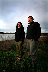 CANADA ALBERTA FORT MCMURRAY 10MAY07 - Mikisew First Nations representatives George Poitras and Melody Lepine (L-R) pose for a photo by the Athabasca River at Fort McMurray, Alberta, Canada...jre/Photo by Jiri Rezac / WWF-UK..© Jiri Rezac 2007..Contact: +44 (0) 7050 110 417.Mobile: +44 (0) 7801 337 683.Office: +44 (0) 20 8968 9635..Email: jiri@jirirezac.com.Web: www.jirirezac.com..© All images Jiri Rezac 2007 - All rights reserved.