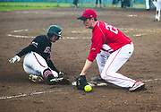 Canada's Derek Mayson fumbles the ball as New Zealand base runner slides into third during playoff 2017 Men's World Softball Championship action on July 15.