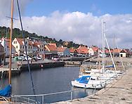 The harbour of the fishing village of<br /> Gudhjem, Bornholm, Denmark<br /> c. Ellen Rooney