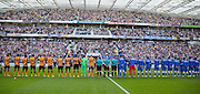 Teams line up for minutes applause in aid of the SHOREHAM disaster during the Sky Bet Championship match between Brighton and Hove Albion and Hull City at the American Express Community Stadium, Brighton and Hove, England on 12 September 2015. Photo by Phil Duncan.