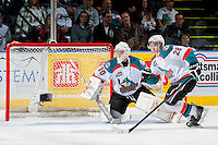 KELOWNA, CANADA - MARCH 22: Jordon Cooke #30 of the Kelowna Rockets defends the net against the Tri-City Americans on March 22, 2014 at Prospera Place in Kelowna, British Columbia, Canada.   (Photo by Marissa Baecker/Shoot the Breeze)  *** Local Caption *** Jordon Cooke;