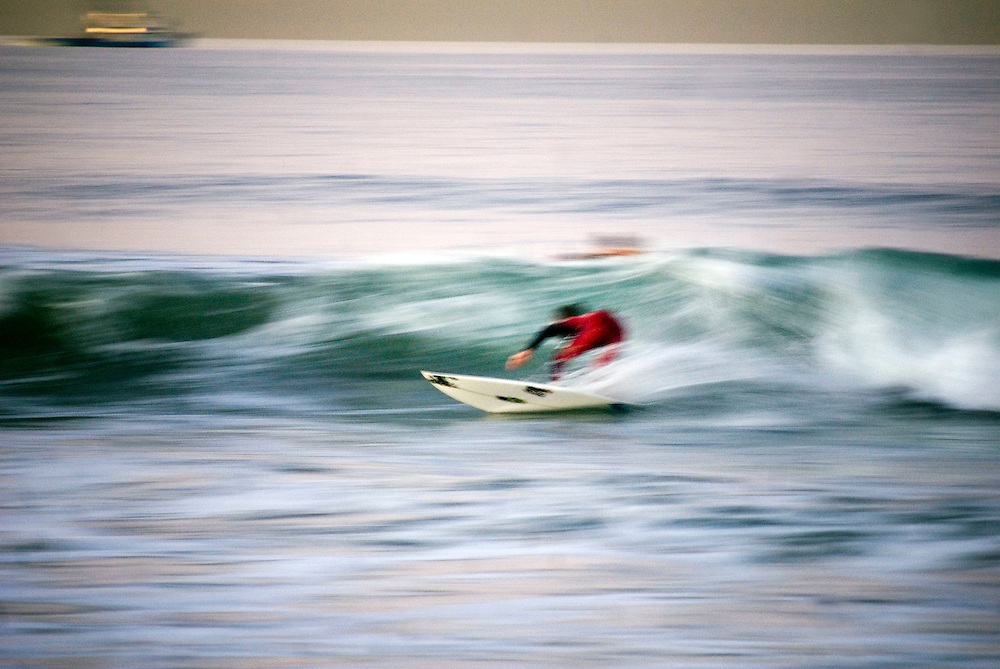 Huntington Beach, California, Surf City, USA..Huntington Beach is a legendary surf beach in California. The surf shop Rockin' Fig Headquarters, run by legendary surfer Rockin Fig, attracts local characters and young surfing talents... ....Photographer: Chris Maluszynski /MOMENT