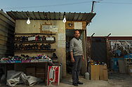 Shoe shop<br /> 42 year-old Salam Toma has been living in the Christian refugee camp in Ankawa, Erbil for one and a half years. He fled his home city of Qaraqosh because of the Islamic State's advance in August, 2014. Toma spent 1,5 million dinar (1,300 US dollars) building this small shop a year ago. He has been working with shoes all his life. He is planning to migrate to Australia with his family.