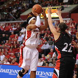 Feb 24, 2009; Piscataway, NJ, USA; Rutgers guard Khadijah Rushdan (1) puts up a shot over the falling Cincinnati guard Kahla Roudebush (20) and the block attempt by forward Shelly Bellman (22) during the first half of Rutgers' 71-53 victory over Cincinnati at the Louis Brown Athletic Center.