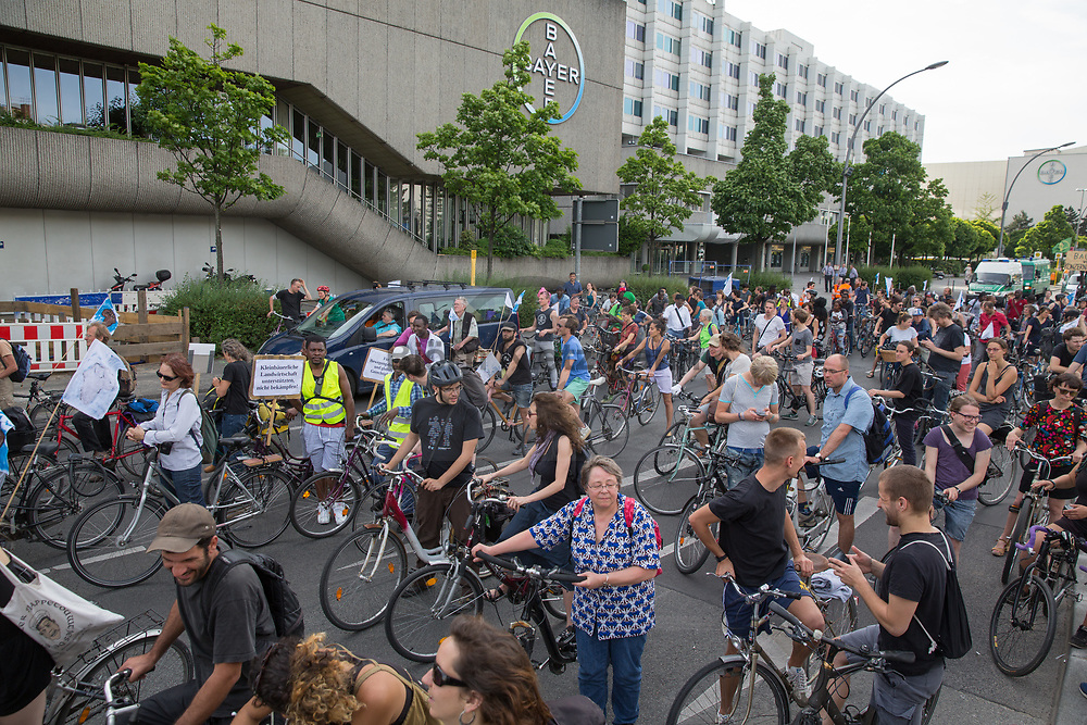 Berlin, Germany - 09.06.2017<br /> <br /> Protest stop in front of the Bayer company site. &rdquo;Visitez les profiteurs&quot; bike rally against the upcoming G20-Africa conference.<br /> <br /> Protestkundgebung vor dem Bayer-Firmengelaende.&rdquo;Visitez les profiteurs&rdquo; Fahrrad Demonstration gegen die bevorstehende G20-Afrika Konferenz.<br /> <br /> Photo: Bjoern Kietzmann