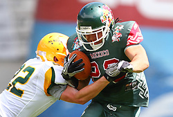 10.07.2011, Tivoli Stadion, Innsbruck, AUT, American Football WM 2011, Group A, Mexico (MEX) vs Australia (AUS), im Bild Damien  Donaldson (Australia, #22, DB) tackles Barrera Jonathan alejandro (Mexico, #23, RB)  // during the American Football World Championship 2011 Group A game, Mexico vs Australia, at Tivoli Stadion, Innsbruck, 2011-07-10, EXPA Pictures © 2011, PhotoCredit: EXPA/ T. Haumer