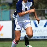 UNCW's Morgan Leyble dribbles the ball against Longwood.