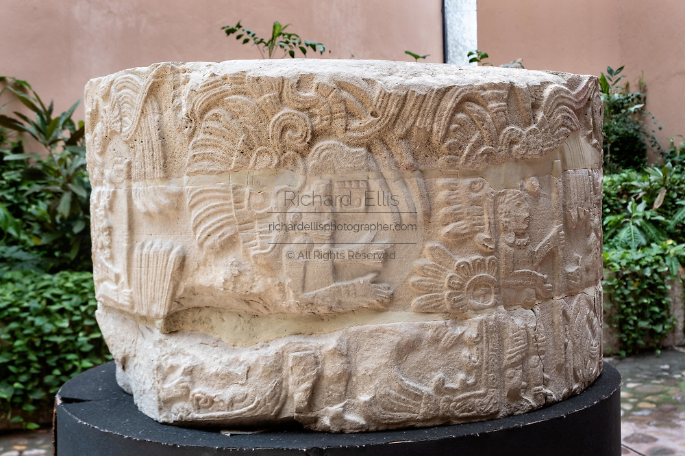 Mesoamerica carved stone column on display in the museum at the pre-Columbian archeological complex of El Tajin in Tajin, Veracruz, Mexico. El Tajín flourished from 600 to 1200 CE and during this time numerous temples, palaces, ballcourts, and pyramids were built by the Totonac people and is one of the largest and most important cities of the Classic era of Mesoamerica.