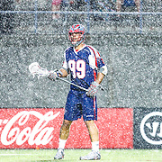 Paul Rabil #99 of the Boston Cannons is seen during a downpour during the game at Harvard Stadium on May 10, 2014 in Boston, Massachusetts. (Photo by Elan Kawesch)