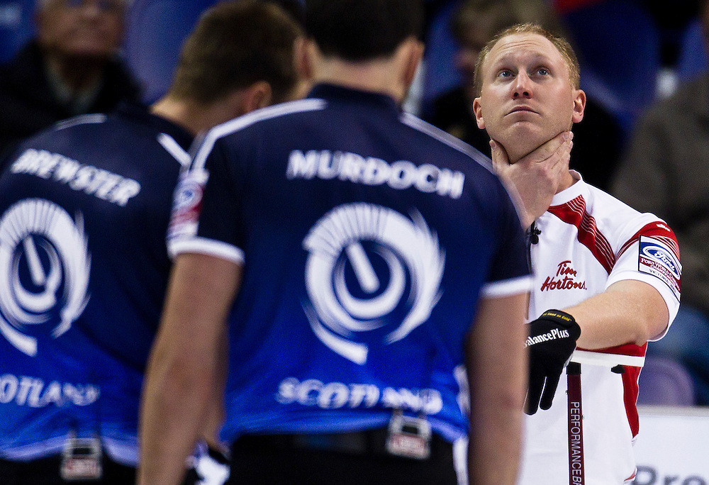 Team Canada skip Brad Jacobs holds his neck at the World Men's Curling Championships in Victoria, British Columbia March 31, 2013.