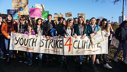 © Licensed to London News Pictures. 29/11/2019. Sheffield , UK. Students hold a big banner and placards as they march through the streets of Sheffield city center during the YouthStrike4Climate. Hundreds of students walk out of their lessons as they head to the streets to demonstrate part of a global youth action over climate change. . Photo credit: Ioannis Alexopoulos /LNP