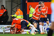 Luke Guttridge  of Luton Town (bottom left) celebrates scoring the opening goal against Northampton Town with team mates during the Sky Bet League 2 match at Kenilworth Road, Luton<br /> Picture by David Horn/Focus Images Ltd +44 7545 970036<br /> 25/10/2014
