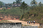 Children walk home from school in El Carbon, Honduras on Thursday April 25, 2013.