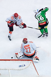 Puck flying to the net, Jamie Fraser (HDD Tilia Olimpija, #44) scores a goal on power play during ice-hockey match between HDD Tilia Olimpija and HK Acroni Jesenice in 23rd Round of EBEL league, on November 20, 2011 at Hala Tivoli, Ljubljana, Slovenia. (Photo By Matic Klansek Velej / Sportida)