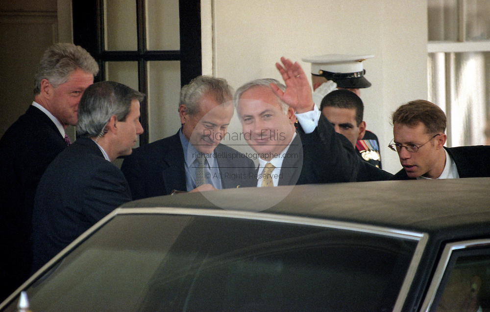 Israeli Prime Minister Benjamin Netanyahu is escorted by President Bill Clinton following their meeting with Palestinian leader Yasser Arafat September 28, 1998 in Washington, DC. Earlier, Israeli diplomats, speaking on condition of anonymity, said there was agreement that Israel would withdraw from an additional 13 percent of the West Bank -- adding to the 27 percent already promised to the Palestinians.