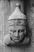 Carved stone figure guarding the side entrance to Saint Mary's Church in Bridgwater.