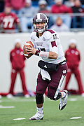 LITTLE ROCK, ARKANSAS - NOVEMBER 23:  Tyler Russell #17 of the Mississippi State Bulldogs rolls out looking to pass the ball against the Arkansas Razorbacks at War Memorial Stadium on November 23, 2013 in Little Rock, Arkansas.  The Bulldogs defeated the Razorbacks 24-17.  (Photo by Wesley Hitt/Getty Images) *** Local Caption *** Tyler Russell