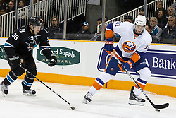 November 11, 2010; San Jose, CA, USA;  New York Islanders center John Tavares (91) is defended by San Jose Sharks center Logan Couture (39) during the first period at HP Pavilion. San Jose defeated New York 2-1 in shootouts. Mandatory Credit: Jason O. Watson / US PRESSWIRE