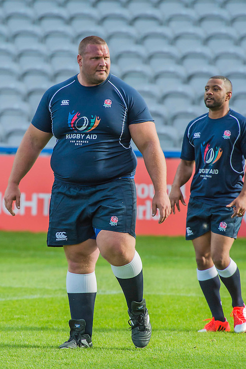 Terry Hollands (Englands strongest man) dwarfs JB Gill - Training starts for inaugural RUGBY AID 2015 charity match which takes place on Friday 4th September 2015 at the Twickenham Stoop. The celebrity charity game will be in aid of RUGBY FOR HEROES  of which Mike Tindall MBE is Patron. The charity raises funds and awareness through the sport of rugby, the fan community and the wider professional player network, to support military personnel who are making the transition back from military service to civilian life. The teams (England v's Rest of the World) include former international rugby players, celebrities and serving members of the armed forces. Harlequins Rugby , The Stoop, Twickenham, London UK, 02 Sept 2015