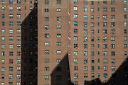 Windows in a red brick apartment block of The Governor Alfred E. Smith Houses, a public housing development built by the New York City Housing Authority in the Two Bridges neighbourhood of the Lower East Side of Manhattan.  There are 12 buildings in this complex, each 17 stories tall and houses approximately 5,739 people.  (photo by Andrew Aitchison / In pictures via Getty Images)