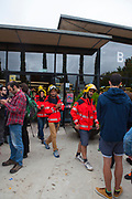 "Firemen at the Biblioteca Central Gabriel Ferrater, Sant Cugat del Valles, just outside Barcelona. Catalonia's firemen were joined by Basque firemen in a pledge to protect voters during the October 1st referendum on independence. Elsewhere in Catalonia, they were attacked by Spanish Guardian Civil and Policia Nacional. One of the firemen, Oriol said ""we just want to protect people"".<br /> <br /> On October 1st 2017, Catalans voted in a binding referendum to decide whether the region should stay in Spain, or leave and become an independent Republic. The Madrid government of Mariano Rajoy sent thousands of extra police into Catalonia, brutally attacking around 10% of  voting centres and seizing ballot boxes, injuring nearly 1000 people in an effort to stop the vote. Despite the violence, there was turn turnout of well more than 42% with around 90% in favour of independence. Some 770,000 votes from an electorate of 5.5 million were stolen by police forces or unable to be cast  because of raids."