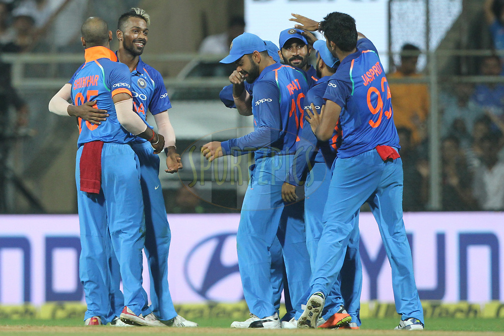 Hardik Pandya of India celebrates the wicket of Martin Guptill of New Zealand during the 1st One Day International match between India and New Zealand held at the Wankhede Stadium in Mumbai on the 22nd October 2017<br /> <br /> Photo by Deepak Malik / BCCI / SPORTZPICS