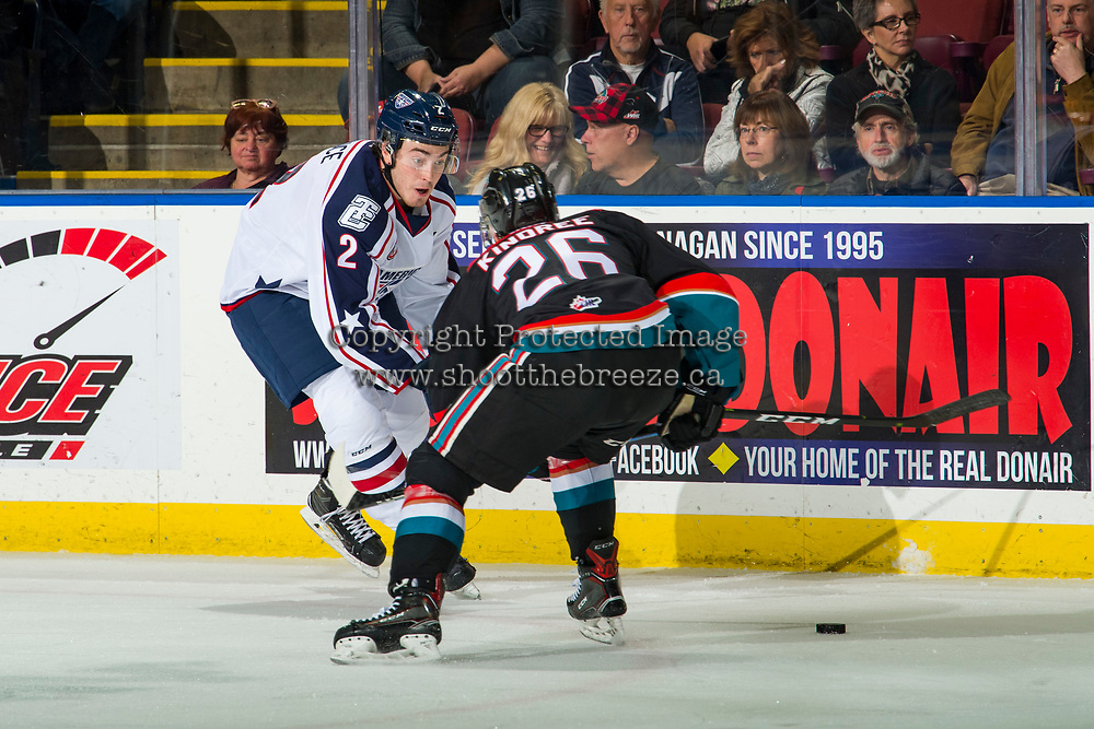 KELOWNA, CANADA - OCTOBER 13: Riley Bruce #2 of the Tri-City Americans is checked by Liam Kindree #26 of the Kelowna Rockets  on October 13, 2018 at Prospera Place in Kelowna, British Columbia, Canada.  (Photo by Marissa Baecker/Shoot the Breeze)  *** Local Caption ***
