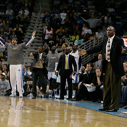 Apr 07, 2010; New Orleans, LA, USA; New Orleans Hornets assistant coach Paul Pressey reacts along with the Hornets bench to an officials call during the second half against the Charlotte Bobcats at the New Orleans Arena. The Bobcats defeated the Hornets 104-103. Mandatory Credit: Derick E. Hingle-US PRESSWIRE