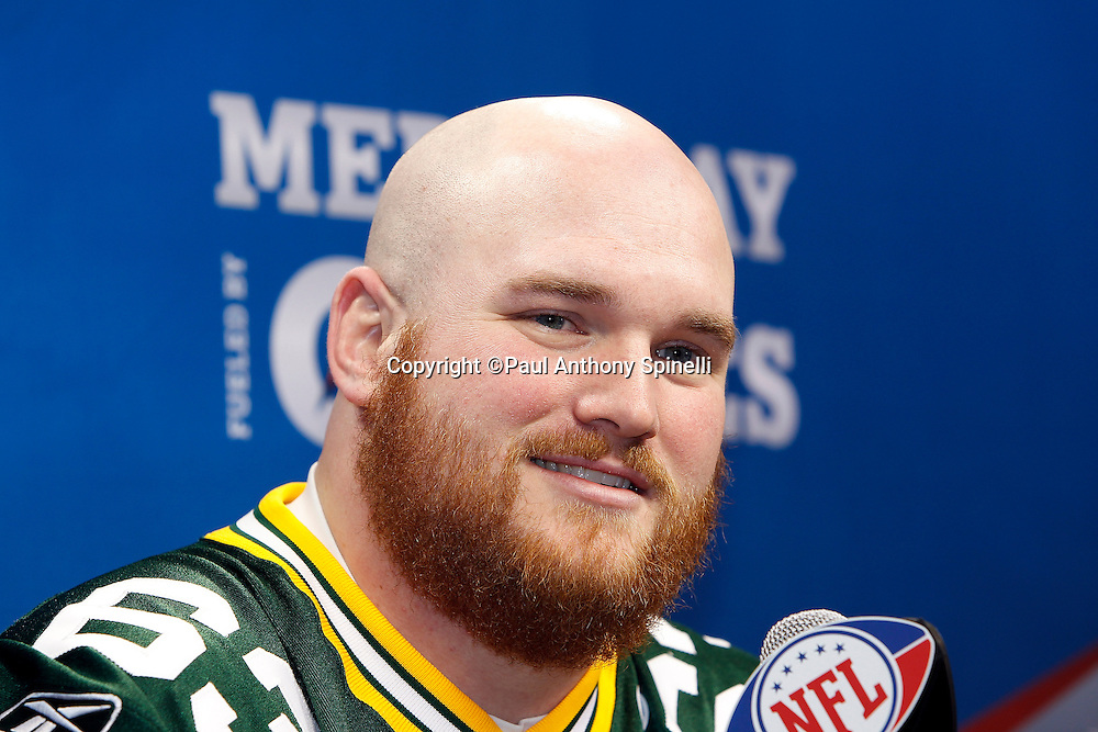 Green Bay Packers center Scott Wells (63) smiles as he speaks to the press at Super Bowl XLV media day prior to NFL Super Bowl XLV against the Pittsburgh Steelers. Media day was held on Tuesday, February 1, 2011 in Arlington, Texas. ©Paul Anthony Spinelli