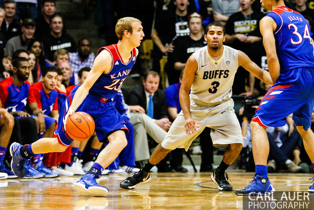 December 7th, 2013:  Kansas Jayhawks freshman guard Conner Frankamp (23) looks to get past Colorado Buffaloes sophomore guard Xavier Talton (3) in the second half of action in the NCAA Basketball game between the Kansas Jayhawks and the University of Colorado Buffaloes at the Coors Events Center in Boulder, Colorado