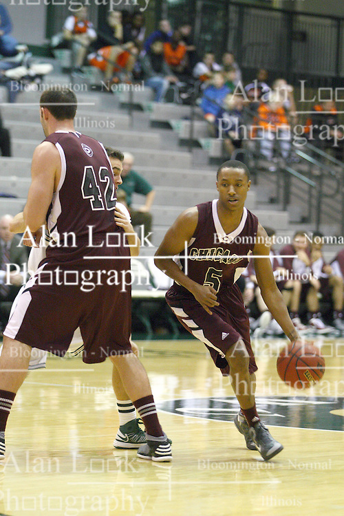 15 December 2012:  Matt MacKenzie provides a screen for Royce Muskeyvalley during an NCAA mens division 3 basketball game between theUniversity of Chicago Maroons and the Illinois Wesleyan Titans in Shirk Center, Bloomington IL