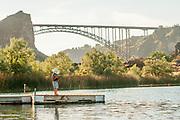 Little boy fishing under the Perrine Bridge at Bass Lake in Twin Falls, Idaho.
