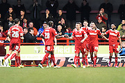 Crawley Town players celebrate and congratulate Richard Wood after his goal during the Sky Bet League 1 match between Crawley Town and Sheffield Utd at Broadfield Stadium, Crawley, England on 28 February 2015. Photo by David Charbit.