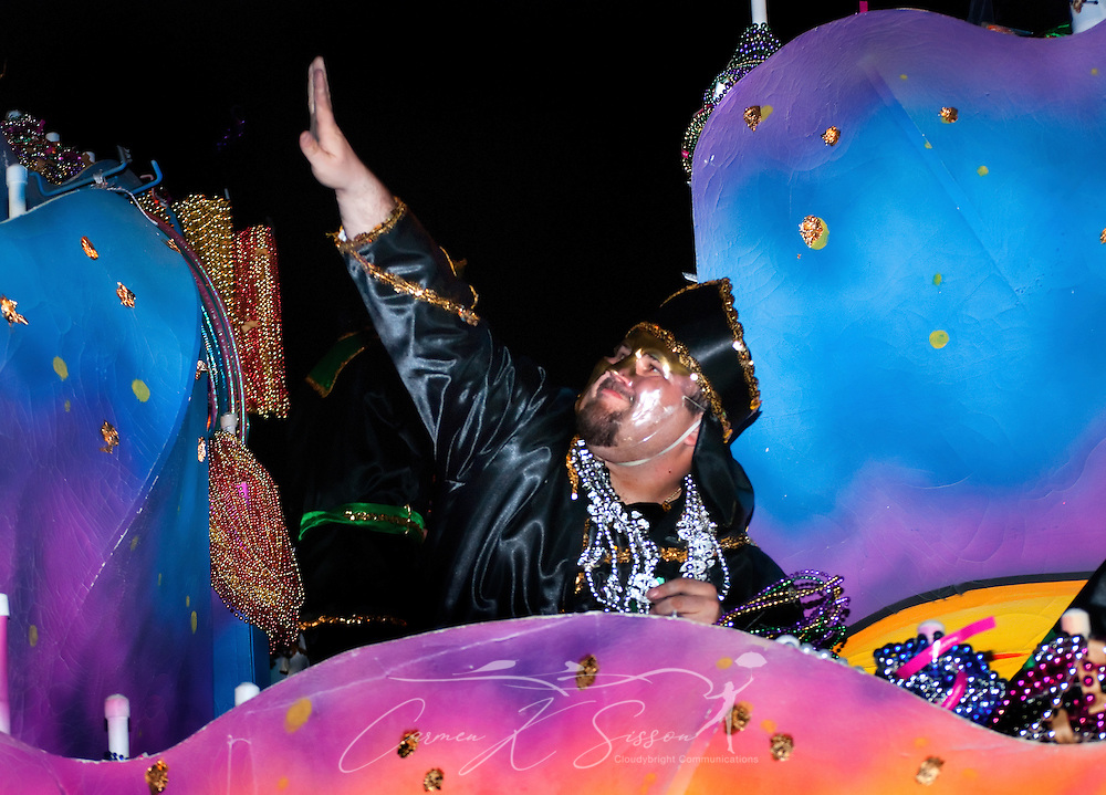 A reveler throws waves to the crowd during the Order of Inca Mardi Gras parade in downtown Mobile, Ala. Feb. 25, 2011. An estimated 84,484 people attended the parade in Mobile, which claims to have the oldest carnival celebration in the United States, dating back to 1703. (Photo by Carmen K. Sisson/Cloudybright)
