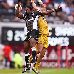 DURBAN, SOUTH AFRICA - MAY 07: Lwazi Mvovo of the Cell C Sharks out jumps Cory Jane of the Hurricanes during the Super Rugby match between Cell C Sharks and Hurricanes at Growthpoint Kings Park on May 07, 2016 in Durban, South Africa. (Photo by Steve Haag /Gallo Images)