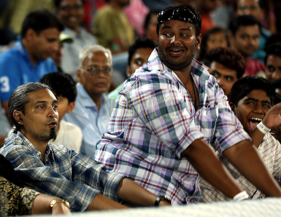 Fans Enjoys during match 7 of the Oppo Champions League Twenty20 between the Kolkata Knight Riders and the Lahore Lions held at the Rajiv Gandhi Cricket Stadium, Hyderabad, India on the 21st September 2014<br /> <br /> Photo by:  Sandeep Shetty / Sportzpics/ CLT20<br /> <br /> <br /> Image use is subject to the terms and conditions as laid out by the BCCI/ CLT20.  The terms and conditions can be downloaded here:<br /> <br /> http://sportzpics.photoshelter.com/gallery/CLT20-Image-Terms-and-Conditions-2014/G0000IfNJn535VPU/C0000QhhKadWcjYs