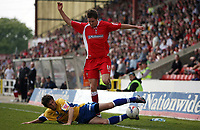 Photo: Rich Eaton.<br /> <br /> Swindon Town v Mansfield Town. Coca Cola League 2. 21/04/2007. Barry Corr scorer of Swindons 2 first half goals is tackled by Ashley Kitchen of Mansfield